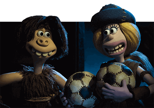 Goona and Dug smiling at each other. Goona is holding two footballs to her chest.